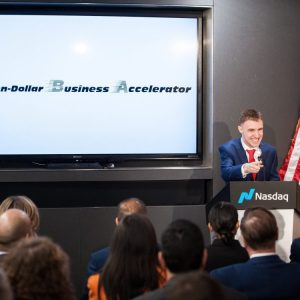 Alexander Velitchko speaking in front of an audience of entrepreneurs & experts inside Nasdaq in New York City